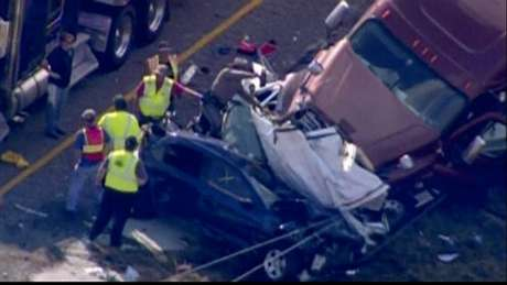 Emergency personnel, on the scene of a pileup of 80 to 100 vehicles on a foggy Texas interstate near Beaumont, are pictured in this still image taken from video courtesy of KPRC-TV, November 22, 2012.