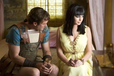 "Grant Bowler as Richard Burton (L) and Lindsay Lohan as Elizabeth Taylor (R) in a publicity image for the Lifetime Original Movie, ""Liz & Dick"""