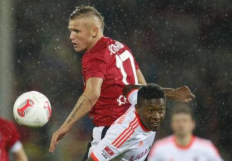 Bayern Munich's David Alaba (R) challenges SC Freiburg's Jonathan Schmid.