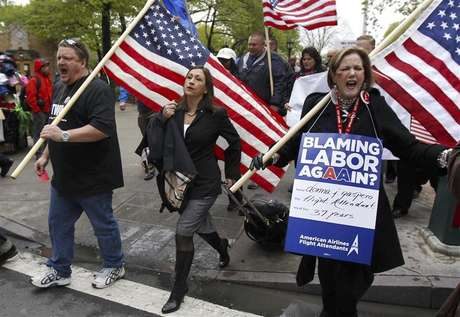 Donna J. Gaspero (R), an American Airlines flight attendant for 37 years, marches with Laura Glading (C), president of the Association of Professional Flight Attendants (APFA), during a rally to save jobs at American Airlines and American Eagle, as hearings to void labor contracts begin at the U.S. Bankruptcy Court in New York in this April 23, 2012, file photo. Pilots at United Airlines and American Airlines are due to vote in coming weeks on new labor contracts that in some cases offer the first significant raises in almost a decade. But the carriers, citing high risks that the recovery in their fortunes could stall, are not prepared to improve contracts across the board, industry experts and airline executives say. That means labor relations could remain rocky. Flight attendants for U.S. Airways Group voted overwhelmingly last week to authorize a strike, saying their latest contract offer still reflects the days when airline profits were in free-fall. To match Analysis AIRLINES-LABOR/