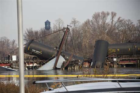 Derailed freight train cars sit semi-submerged in the waters of Mantua Creek after a train crash, in Paulsboro, New Jersey, November 30, 2012.