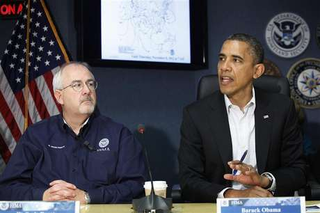 U.S. President Barack Obama (R), sitting with Federal Emergency Management Agency (FEMA) administrator William Craig Fugate (L), talks to reporters after a briefing about operations in the aftermath of Hurricane Sandy, at FEMA headquarters in Washington, November 3, 2012.