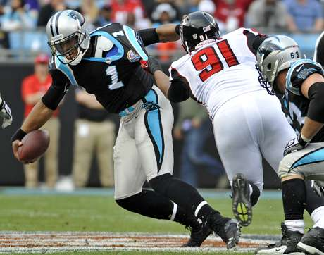 "Carolina Panthers' <font color=""red"">Cam</font> <font color=""red"">Newton</font> (1) pulls away from the tackle of Atlanta Falcons' Corey Peters (91) during the first half of an NFL football game in Charlotte, N.C., Sunday, Dec. 9, 2012."