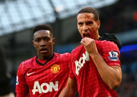 Rio Ferdinand of Manchester United is helped by team-mate Danny Welbeck (L) after being struck by an object during the Barclays Premier League match between Manchester City and Manchester United at Etihad Stadium on December 9, 2012 in Manchester, England.