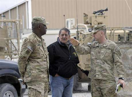 U.S. Defense Secretary Leon Panetta (C) talks with U.S. Army Major General Robert Abrams and Command Sergeant Major (CSM) Edd Watson (L) during a visit to Kandahar Airfield in Kandahar December 13, 2012.