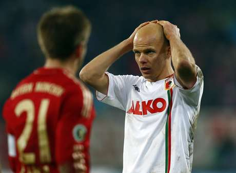 Augsburg's Tobias Werner reacts during their German DFB Cup (DFB Pokal) round of sixteen soccer match against Bayern Munich in Augsburg December 18, 2012.