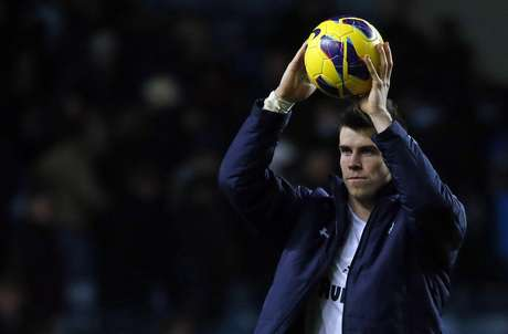 Tottenham Hotspur's Gareth Bale celebrates their win against Aston Villa with the match ball for scoring a hat-trick.