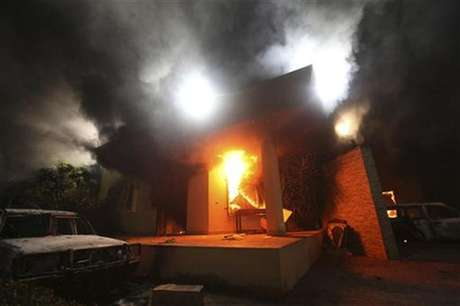 The U.S. Consulate in Benghazi is seen in flames during a protest by an armed group said to have been protesting a film being produced in the United States September 11, 2012.
