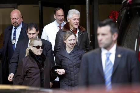 U.S. Secretary of State Hillary Clinton (L) leaves New York Presbyterian Hospital with husband, Bill (TOP), and daughter, Chelsea (C), in New York, January 2, 2013. The secretary of state, who has not been seen in public since Dec. 7, was revealed on Sunday evening to be in a New York hospital under treatment for a blood clot that stemmed from a concussion she suffered in mid-December.