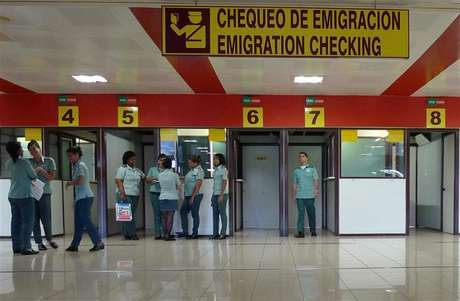 Immigration officers wait for travellers at the control checkpoint at Havana's Jose Marti International Airport October 16, 2012.
