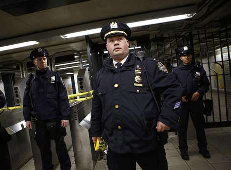 Police officers are seen at a closed subway station in New York January 15, 2013.