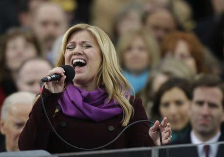 """Kelly Clarkson performs """"My Country 'Tis of Thee"""" at President Barack Obama's second inauguration. The singer and fellow pop diva Beyoncé were among the guests at Obama's swearing in on Monday, January 21."""