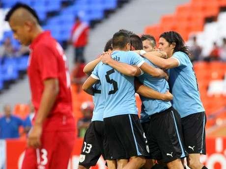 Uruguay easily topped 10-man Peru.