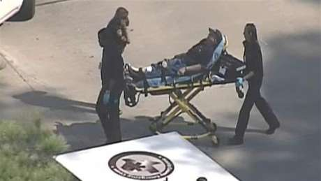 Police and emergency personnel evacuate an injured male on a stretcher outside a building on the Lone Star College Campus near Houston, Texas in this still image taken from video courtesy of KPRC-TV Houston January 22, 2013. Multiple people have been shot according to news reports.