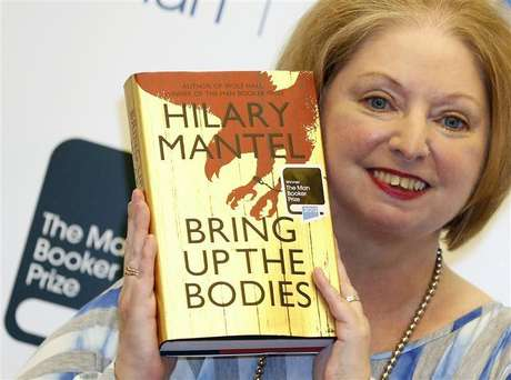 """Author Hilary Mantel poses with her book """"Bring up the Bodies"""", after winning the 2012 Man Booker Prize, at the Guildhall in London October 16, 2012."""