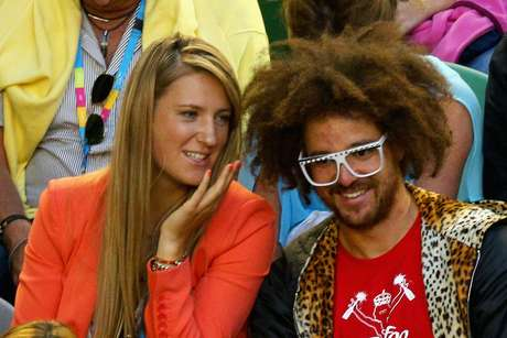 New Australian Open champion Victoria Azarenka and LMFAO memeber Stefan Gordy aka Redfoo watch the men's final between Djokovic and Murray.