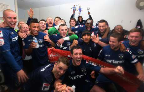 Oldhham Athletic pplayers celebrate after they eliminated Liverpool in the 4th round of the FA Cup.