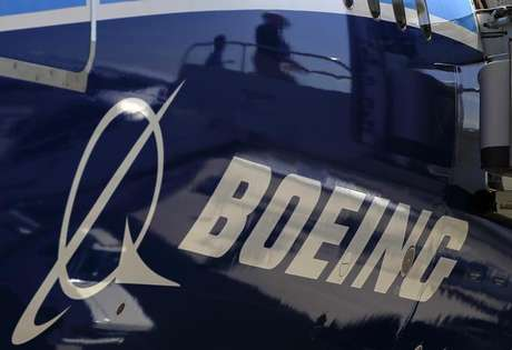 The Boeing logo is seen on a Boeing 787 Dreamliner airplane in Long Beach, California March 14, 2012.