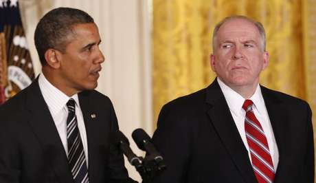 White House counterterrorism advisor John Brennan (R) listens as U.S. President Barack Obama nominates him to become the next CIA director at the White House in Washington January 7, 2013.