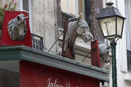 Metal horse heads are seen above a closed horsemeat butcher shop in Paris January 16, 2013.