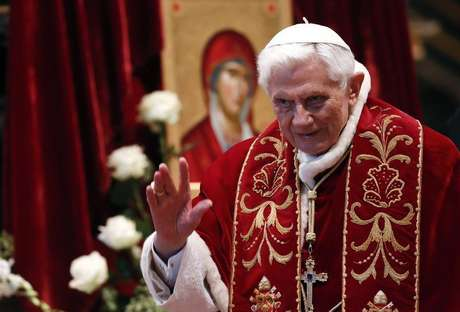 Pope Benedict XVI waves during a mass conducted by Cardinal Tarcisio Bertone, for the 900th anniversary of the Order of the Knights of Malta at the St. Peter Basilica in Vatican February 9, 2013.