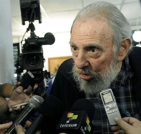 Former Cuban leader Fidel Castro speaks to reporters at a polling station in Havana February 3, 2013.
