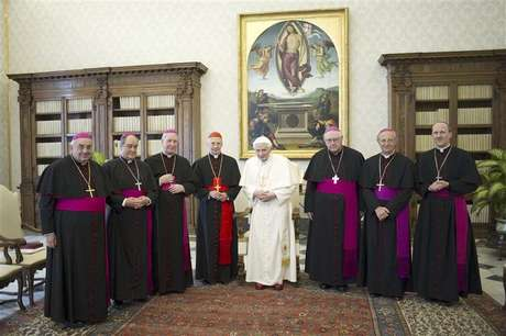 Pope Benedict XVI poses with Italian cardinal Angelo Bagnasco (4th L) and bishops from the Liguria region during a meeting at the Vatican February 15, 2013.