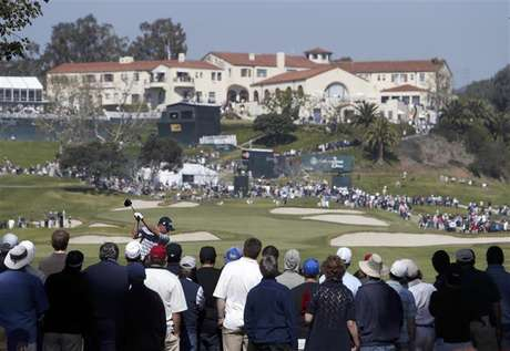 John Merrick of the U.S. tees off on the ninth hole with the clubhouse above the ninth green during the final round of the Northern Trust Open golf tournament at Riviera Country Club in Los Angeles February 17, 2013.