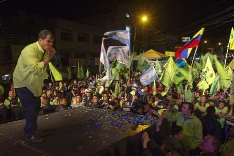 Ecuador's President Rafael Correa addresses his supporters from a balcony of Carondelet Palace in Quito February 17, 2013.
