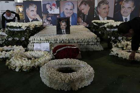 Wreaths and pictures of Lebanon's former Prime Minister Rafik al-Hariri are seen at his gravesite in downtown Beirut February 14, 2013. Thursday marks the eighth anniversary of Hariri's assassination.