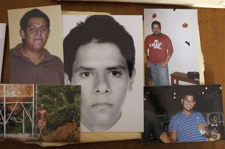 Photographs of five of the six young men abducted by soldiers are seen at a desk in Iguala, in the Mexican state of Guerrero February 20, 2013.