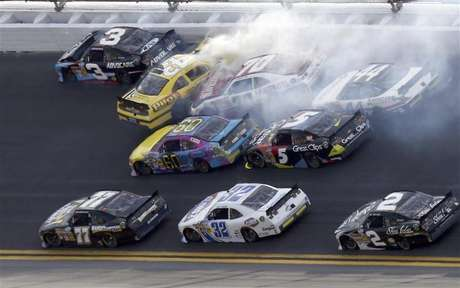 NASCAR driver Tony Stewart (bottom R) avoids a crash on the last lap to win the NASCAR Nationwide Series DRIVE4COPD 300 race at the Daytona International Speedway in Daytona Beach, Florida February 23, 2013.