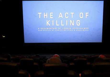 "The opening of ""The Act of Killing"", a documentary made by Texan-born director Joshua Oppenheimer, is pictured during an underground screening at a theatre in Jakarta February 6, 2013."
