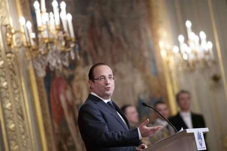 France's President Francois Hollande delivers his speech during an awards ceremony at the Elysee Palace in Paris, February 26, 2013.