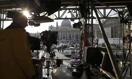 A technician works on structure set up for TV media in front of St. Peter's Square in Rome February 26, 2013.