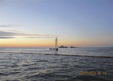 An inactive wellhead owned by Swift Energy is seen discharging an oily-watery mixture after being struck by a 42-foot crewboat, the Sea Rider, off the coast of Port Sulphur, Louisiana February 26, 2013 in this U.S. Coast Guard handout photo released February 27, 2013. The Coast Guard is responding to the incident and is working with federal, state and local agencies as well as Swift Energy to secure the well and contain and clean up any oil that is leaking.