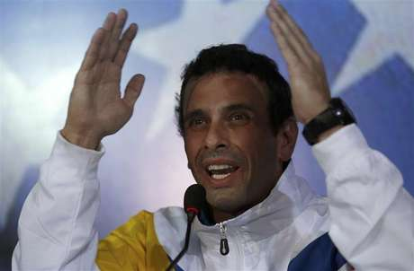 Venezuela's opposition leader and presidential candidate Henrique Capriles gestures during a news conference in Caracas March 11, 2013.