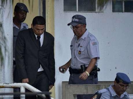 <p><strong>14 de março</strong> - Após ser condenado a 20 anos de prisão, Mizael deixa o fórum de Guarulhos escoltado</p>