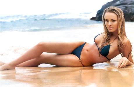 <p>Florida Gulf Coast University men's basketball coach Andy Enfield is living quite the life these days. In addition to guiding his team to the NCAA Tournament for the first time in school history, he also is married to former Maxim model Amanda Marcum Enfield. Here are some photos of the lovely Mrs. Enfield, who is sure to be a major attraction for cameras during the tournament.</p>