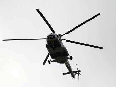Un helicóptero sobrevuela el desfile del 16 de septiembre.