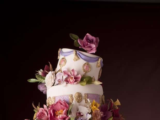 http://p2.trrsf.com/image/fget/cf/67/51/images.terra.com/2012/12/14/the-king-cake-banana-cake-com-gianduia-e-capuccino-e-cobertura-de-pasta-de-acucar.jpg