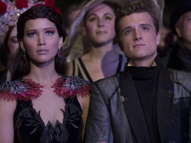 O ator Josh Hutcherson em cena com Jennifer Lawrence no longa 'Jogos Vorazes: Em Chamas' Foto: Divulgação