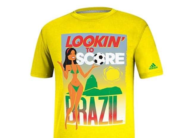 """Frase """"Lookin' to score"""" (algo como """"querendo gols"""") é acompanhada da imagem de uma mulher na camiseta Foto: Adidas / Reprodução"""