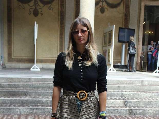 http://p2.trrsf.com/image/fget/cf/67/51/images.terra.com/2012/09/21/a-fashionista-capturou-imediatamente-as-tendencias-peplum-clutch-sapato-prateado-e-camisa-masculina.JPG