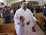 The young priest, who was born in 1972, has received some criticism from the faithful for wearing jeans, shirts and shoes; but he has attracted children and adults to Sunday Mass.