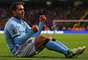 Carlos Tevez drives a car in Manchester City's 5-0 win over Aston Villa.