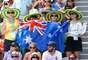 This group of Australian women cheer for compatriot Bernard Tomic during the match against German Daniel Brands