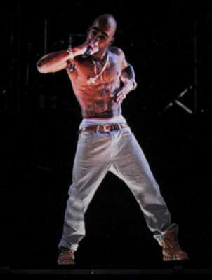 """Tupac Shakur """"hit"""" the stage at Coachella in hologram form this Sunday on April 15 in Indio, CA. The holographic image, """"performed"""" """"Hail Mary"""" and """"2 of Amerikaz Most Wanted"""" during Dr. Dre and Snoop Dogg's set. Whilst many were amazed by the technology behind it, many fans reacted in horror on Twitter, calling it wrong, terrifying, etc. We're,honestly creeped out by it as well, but maybe that ties into our fear of mannequins. WATCH THE VIDEO BELOW AND TELL US WHAT YOU THINK!.Rihanna: Vampy With Black Hair & Sizzling Red Lips I Sean Paul Is Still Around"""