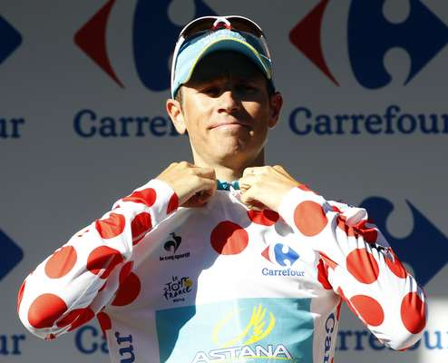Astana Pro Team rider Fredrik Kessiakoff of Sweden wears the best climber's polka dot jersey on the podium after the 11th stage of the 99th Tour de France cycling race between Albertville and La Toussuire.