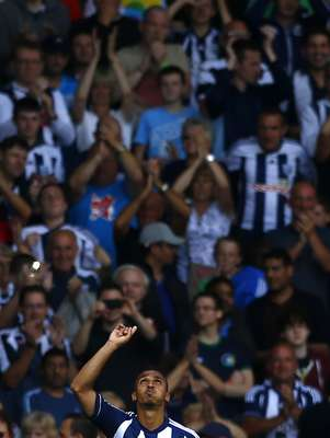 West Bromwich Albion's Peter Odemwingie celebrates scoring a penalty against Liverpool during their English Premier League soccer match.